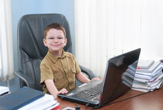 Smiling boy with the laptop Stock Photography