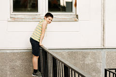 Smiling boy leaning on a fence rail Royalty Free Stock Photo
