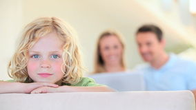 Smiling boy leaning on a sofa stock footage