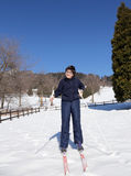 Smiling boy learns to ski cross-country in winter Stock Image