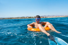 Free Smiling Boy Learns To Swim On Lifebuoy In The Sea Royalty Free Stock Photo - 88463445