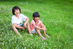 A smiling boy and a little girl Stock Photography