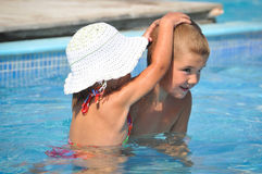 Smiling boy and little girl swimming in pool Stock Image