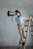Smiling boy. Little producer with a megaphone royalty free stock photo