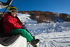 Smiling boy, little skier sitting in the car boot Royalty Free Stock Photo