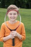 Smiling boy looking through badminton racquet Royalty Free Stock Image