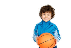 Smiling boy looking at camera with a basket ball Royalty Free Stock Images
