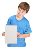 Smiling boy looking at epmty board in his hand Stock Image