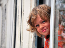 Smiling boy looking out Stock Photography