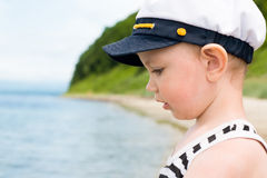 Smiling boy looking at the sea. Royalty Free Stock Photos
