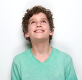 Smiling boy looking up Royalty Free Stock Images