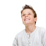 Smiling boy looking up. Close up portrait of smiling boy looking up.Isolated on white Stock Photography