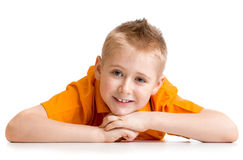 Smiling boy lying on floor isolated Stock Photos