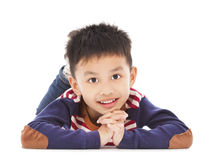Smiling boy is lying on the floor Royalty Free Stock Photography