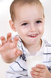Smiling boy with milk glass Royalty Free Stock Photography