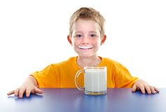 Smiling boy with milk mustache