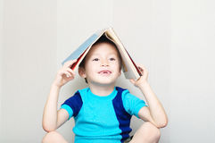Smiling boy missing milk tooth with book Royalty Free Stock Photo