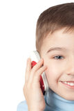 Smiling boy with mobile phone. Over white background royalty free stock photo