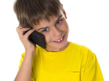 Smiling boy with mobile phone Royalty Free Stock Images