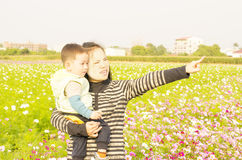 Smiling boy and mother in meadow Royalty Free Stock Image
