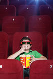 Smiling boy in the movie theatre Stock Photos