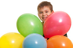 Smiling boy in the multicolored balloons Royalty Free Stock Photography