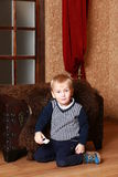 Smiling boy near the chest Royalty Free Stock Photography