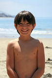 Smiling Boy On Beach Royalty Free Stock Photography