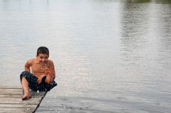 Free Smiling Boy On The Pier Stock Photography - 5048342