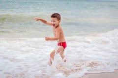 Free Smiling Boy On The Sea Royalty Free Stock Photos - 66831228