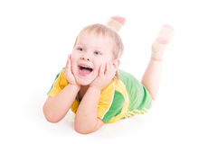 A smiling boy with the open mouth on the floor Royalty Free Stock Images