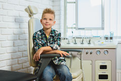 Smiling boy in Otolaryngologist cabinet at clinic Royalty Free Stock Photo