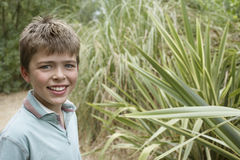 Smiling Boy By Outdoor Plant Stock Photos