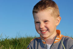 Smiling boy outdoors Royalty Free Stock Images