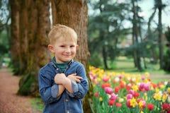 Smiling boy outdoors portrait. In Groot-Bijgaarden, Belgium at springtime stock photography