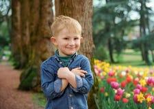 Smiling boy outdoors portrait. In Groot-Bijgaarden, Belgium at springtime royalty free stock photo