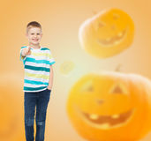 Smiling boy over pumpkins background Royalty Free Stock Image