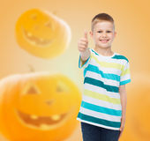 Smiling boy over pumpkins background Royalty Free Stock Photography