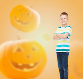 Smiling boy over pumpkins background Stock Photography