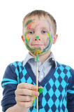 Smiling boy with the paintbrush. Royalty Free Stock Images
