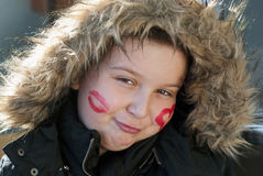 Smiling boy with painted hearts on the face Royalty Free Stock Photos