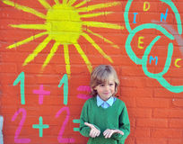 Smiling boy at the painted school wall Royalty Free Stock Photography