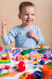 Smiling boy painting Stock Photos
