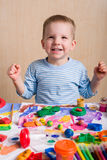 Smiling boy painting Royalty Free Stock Images