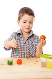 Smiling boy painting easter eggs Royalty Free Stock Photo