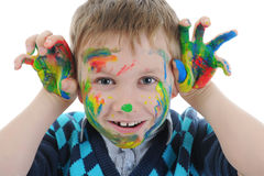 Smiling boy with the palms painted by a paint. Stock Photography