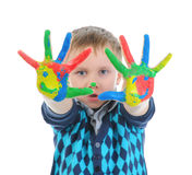 Smiling boy with the palms painted by a paint. Stock Photos