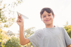 Smiling boy with paper plane in the park Royalty Free Stock Images