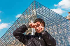 Smiling boy in Paris near the Louvre pyramid Stock Photo