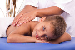 Smiling boy with the physiatrist in therapy Stock Images